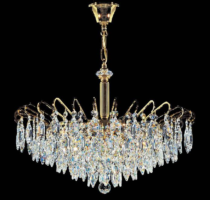 the crystal chandelier lights up the paintings. Black Bedroom Furniture Sets. Home Design Ideas